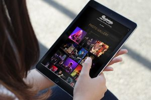 photo gallery on iPad from website redesign for Beginnings Chicago Tribute Band