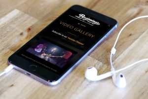 video page from website redesign for Beginnings Chicago Tribute Band
